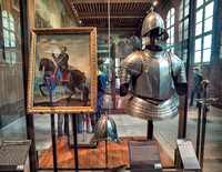 "On left is portrait of Henry IV (1553–1610) known as ""Good King Henry"" also King of Navarre & King of France.  On right is a suit of ""half"" armour ""related"" to Henry IV (might or might not have used)."