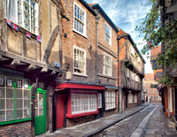 The Shambles.   The pavements are raised either side of the cobbled street to form a channel where the butchers would wash away their offal and blood twice a week.