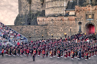 Massed Pipes and Drums emerge from the castle.