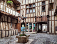 Timber frame houses turned into shops surround a courtyard off of Cat Alley.