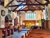 Interior of St Oswald's showing the south or old (1300s) part of the church and to the left the new (1490-1500) second nave which doubled the size of the church.