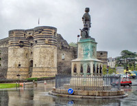 On the left are the outer walls of the Chateau d'Angers on the banks of the river Maine.  The statue is René of Anjou (19 Jan 1409 – 10 Aug 1480) also known as René I of Naples & Good King René.