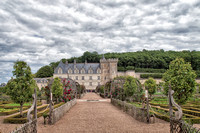 Looking northeast through kitchen gardens at the chateau - original castle keep on right side of the building.  The walkways of the belvedere extend along the hillside to the right above the gardens.