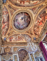Salon of War ceiling represents France in center, surrounded by Victories. Louis XIV decorates her shield. The flanking panels are the three conquered enemies: Germany, Spain & Holland.
