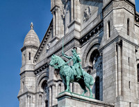 Equestrian statue of Saint Joan of Arc in front of the Basilica.