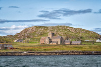 View of the Iona Abbey with Dun I in the background from the boat on the way to Staffa.