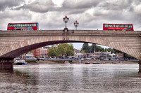 Putney Bridge, London. Famous as the starting point of the annual Oxford and Cambridge University Boat Race, this version was opened by the Prince and Princess of Wales in 1886.