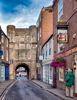 "Bootham Bar is on the site of one of the four main entrances to the Roman fortress. As seen from the ""inside"" on High Petergate Street, York, UK."