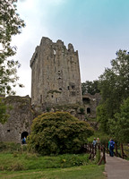 The north side of Blarney Castle towers abruptly on the bluff overlooking the adjacent stream.