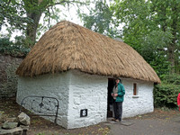 Bunratty Folk Park - Bothan Scoir, a single-room dwelling of a poor landless labourer. Door required Jim Stoutamire to stoop to enter.