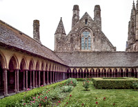 Mont Saint-Michel cloister gardens with the face of the refectory building in the left rear.