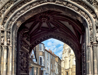 View through Christ Church Gate - historic buildings (now lodgings) on the left - the Cathedral to the right.