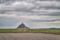 Mont Saint-Michel on the left and on the right a very similar but never built on, tidal island of Tombelaine, which is now a bird preserve.