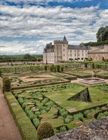 Looking north northeast across the garden toward the chateau with the original castle keep in the center forming one corner of the chateau. Note the interesting plantings in the near garden.