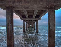 Sunrise and an interesting visual effect while standing under the Horace Caldwell Pier.