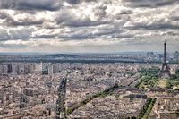 "Looking northwest from top of the Tour Maine-Montparnasse at the Eiffel Tower and the Parc du Champ-de-Mars.  In middle distance the continuous band of ""green"" marks the course of the Seine River."