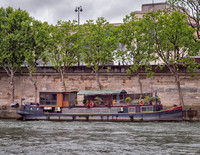 Typical houseboat on the Seine River.
