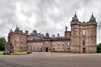 Hollyrood Palace front with 16th-century north-west tower on the left. The rest dates from the 17th century. The forecourt fountain on the left is a Victorian addition.
