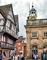 On the left is 1 Broad Street a box frame house built in 1462. On the right is The Buttercross built in 1746.