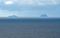 L>R Little Skellig and Skellig Michael in the distance south of the Dingle Peninsula and west of Bolus Head on the Iveragh Peninsula in County Kerry, Ireland.