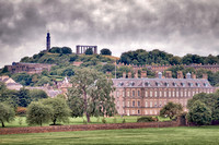 View of Calton Hill with a tower, shaped like an inverted telescope, in honour of Vice Admiral Horatio Nelson; and the pillars of the unfinished, since 1829, National Monument of Scotland.