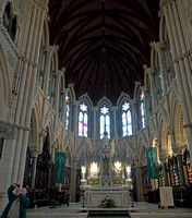 Chancel or high altar end of St Colman's Cathedral, Cobh. Francie Stoutamire captured Jim Stoutamire taking a picture on the lower left.