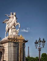 The statue of Renommée, or the fame of the king, riding the horse Pegasus, (1699) by Antoine Coysevox (1640-1720) at the west entrance of the Tuileries Gardens. Originally in the estate of Louis XIV.