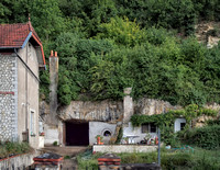 At many places in the Loire River valley, structures are built in part or in whole into steep valley cliff sides which are composed of soft, easily excavated tuffeau (limestone).